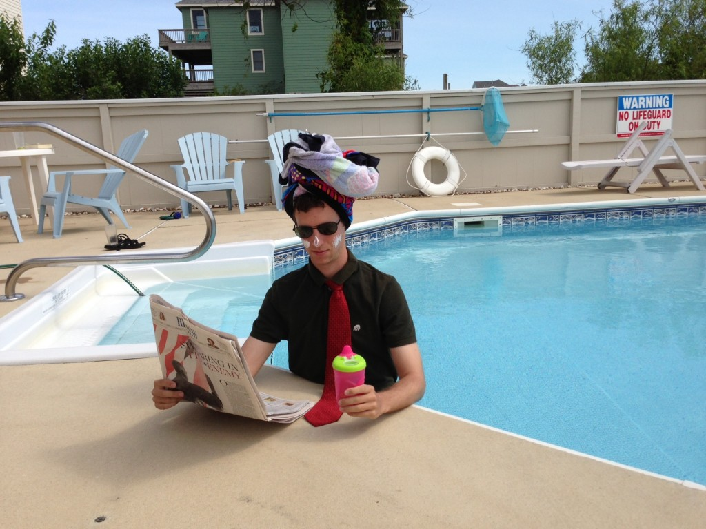 Photo of a bureaucrat relaxing cautiously on vacation.
